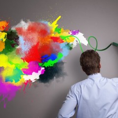 Businessman painting abstract colorful design on gray background concept for  business creativity, i